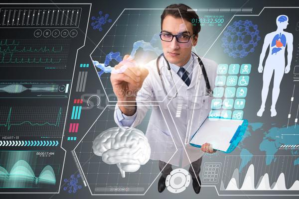 Doctor in futuristic medical concept pressing button Stock photo © Elnur