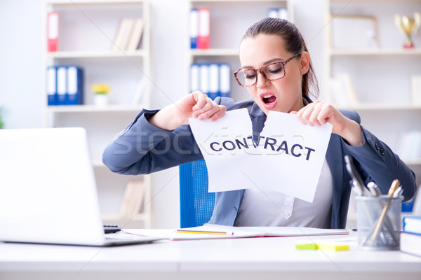 Businesswoman tearing apart her contract Stock photo © Elnur