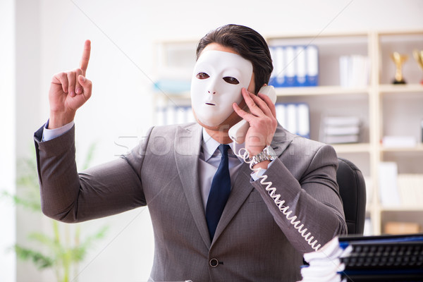 Businessman with mask in office hypocrisy concept Stock photo © Elnur