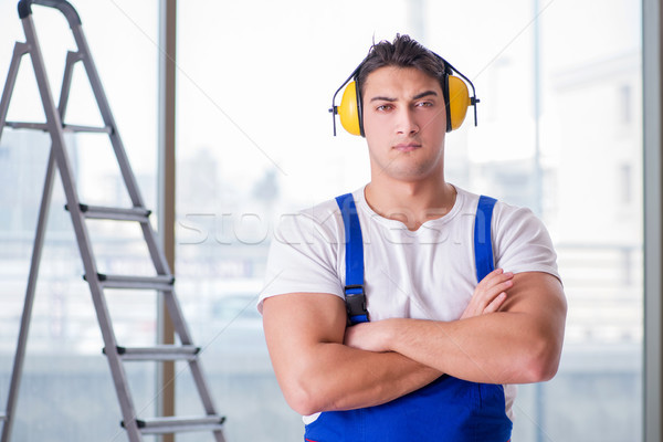 The worker with noise cancelling headphones Stock photo © Elnur