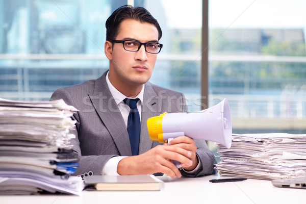 Angry businessman with loudspeaker in the office Stock photo © Elnur