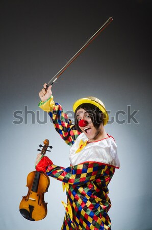 Funny clown with money bags sacks isolated on white background Stock photo © Elnur