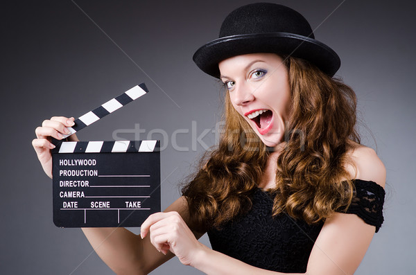 Woman with movie clapper board Stock photo © Elnur