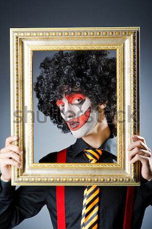 Monster with picture photo frame in dark room0 Stock photo © Elnur