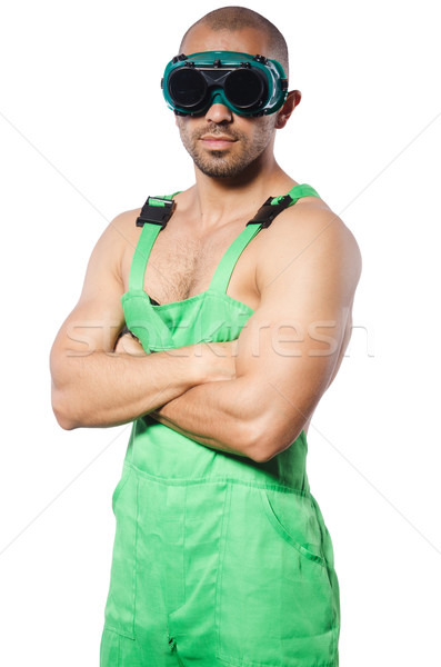 Man in green coveralls with goggles Stock photo © Elnur