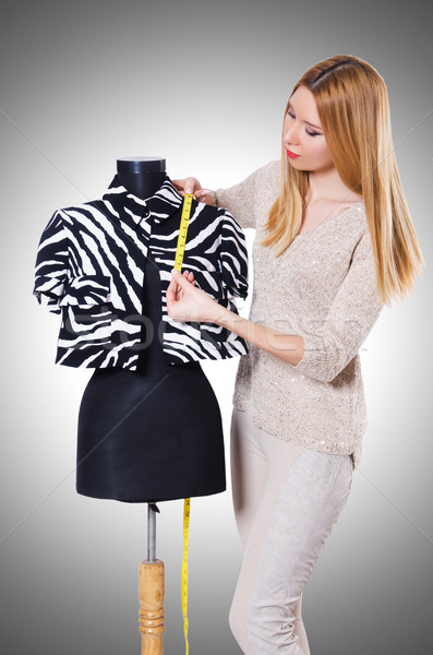 Stock photo: Woman tailor isolated on the white