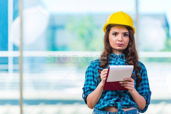 Woman builder taking notes at construction site Stock photo © Elnur