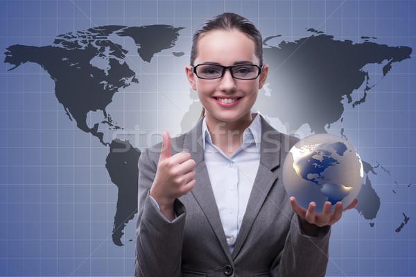 Zakenvrouw wereldwijde business business vrouw wereld aarde Stockfoto © Elnur
