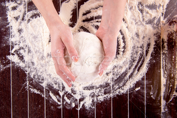 Cook preparing dough for baking in the kitchen Stock photo © Elnur