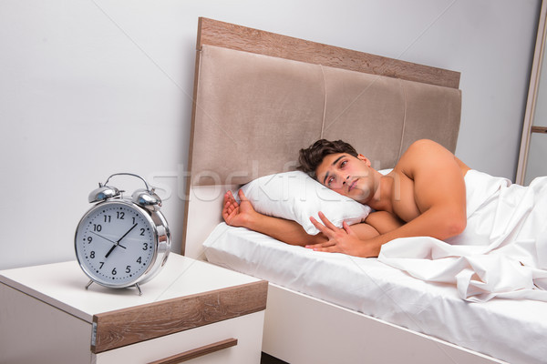 Man having trouble waking up in the morning Stock photo © Elnur