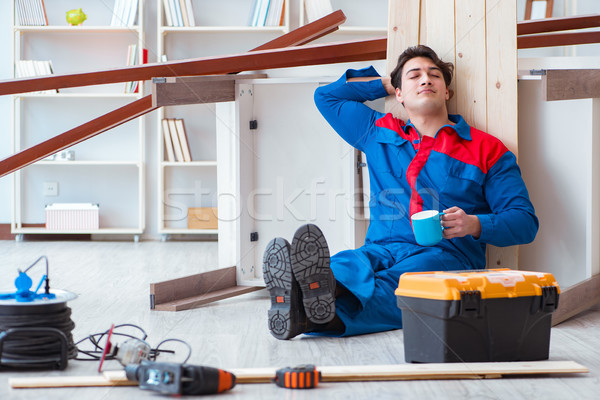The young carpenter taking break from working with wooden planks Stock photo © Elnur