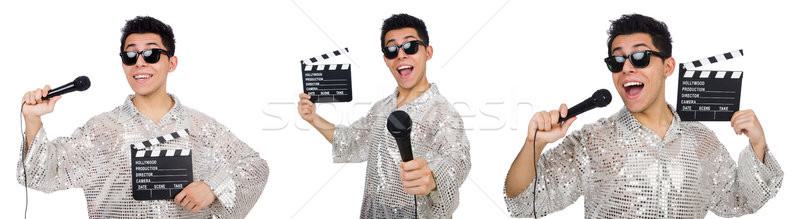 Young man with microphone and clapperboard isolated on white Stock photo © Elnur