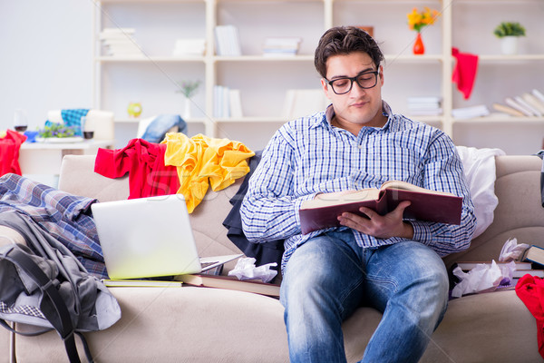 Young man working studying in messy room Stock photo © Elnur