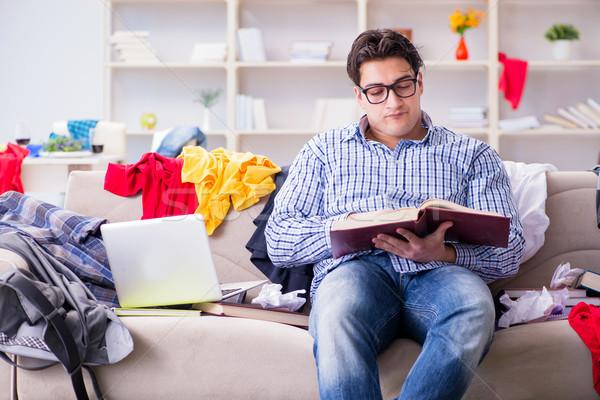 Moço trabalhando estudar confuso quarto casa Foto stock © Elnur