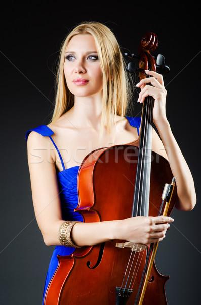 Vonzó nő cselló stúdió nő koncert hegedű Stock fotó © Elnur