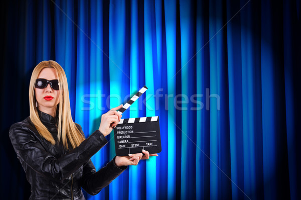 Girl with movie board against curtains Stock photo © Elnur