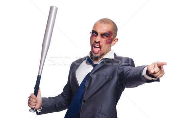 Badly bruised businessman with bat on white Stock photo © Elnur