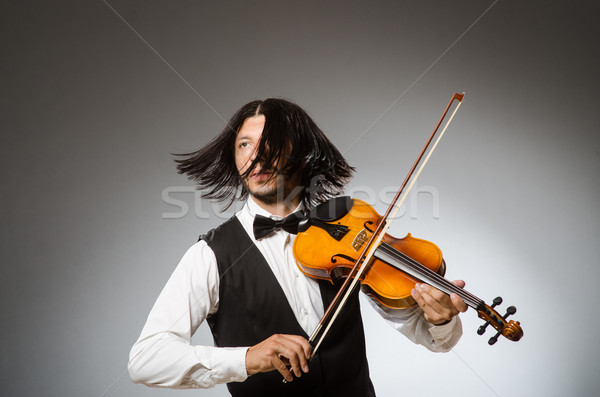 Musician plays cello isolated on white Stock photo © Elnur