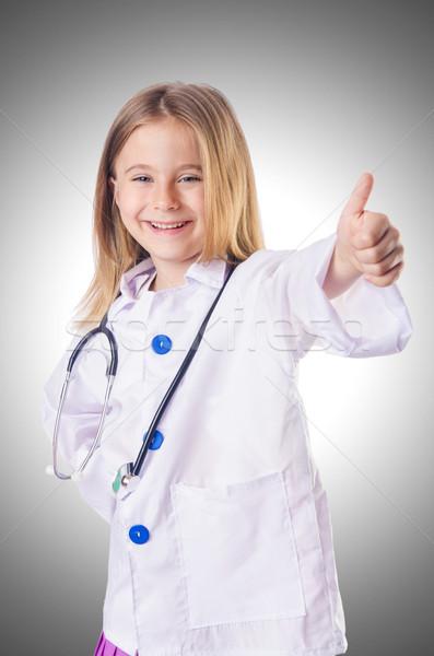 ストックフォト: 女の子 · 医師 · 衣装 · 背景 · 薬 · 楽しい