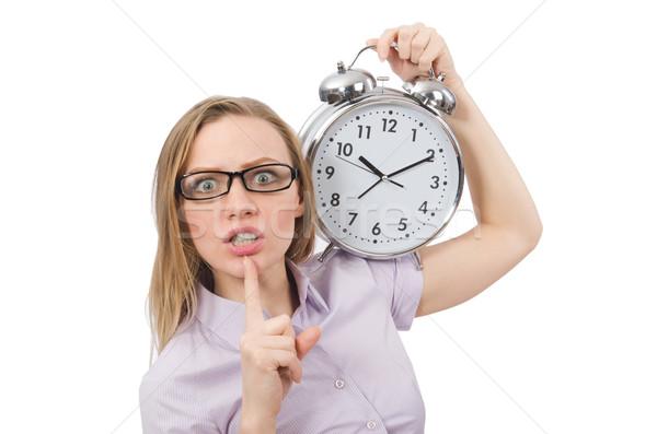 Young employee holding alarm clock isolated on white Stock photo © Elnur