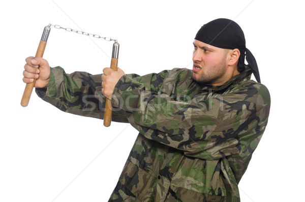 Young man in soldier uniform holding nunchaks isolated on white Stock photo © Elnur