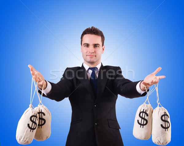 Man with money sacks against the gradient Stock photo © Elnur