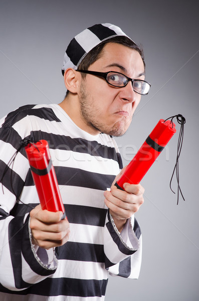 Funny prisoner with dynamite  isolated on gray Stock photo © Elnur