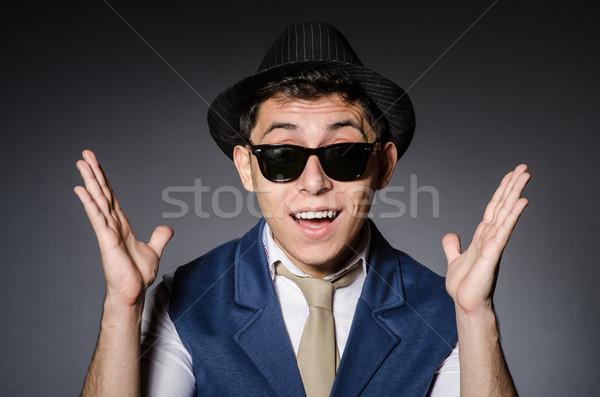 Fiatalember kék mellény kalap szürke férfi Stock fotó © Elnur