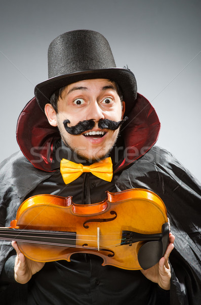 Funny violin player wearing tophat Stock photo © Elnur