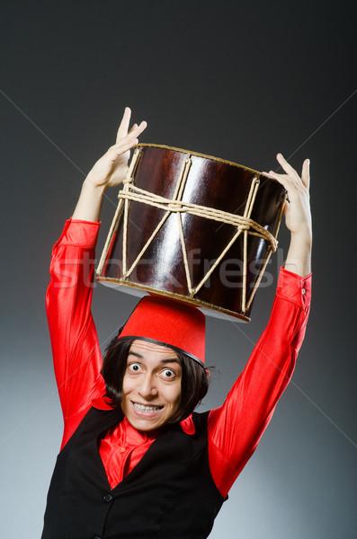 Man wearing red fez hat Stock photo © Elnur