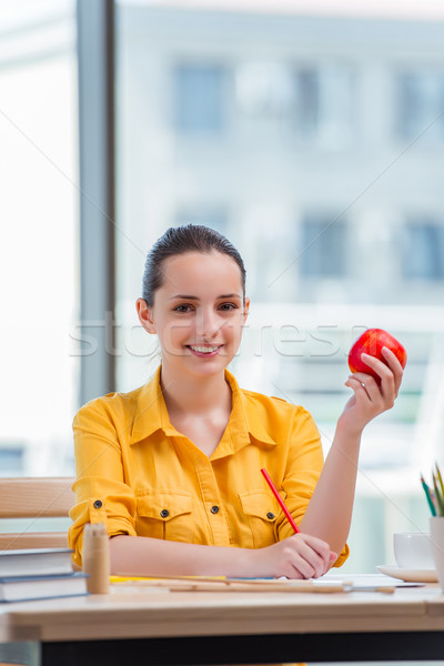 Stock photo: Young school gilr drawing pictures at home