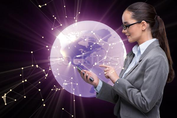 Empresária telefone global de negócios mundo terra espaço Foto stock © Elnur