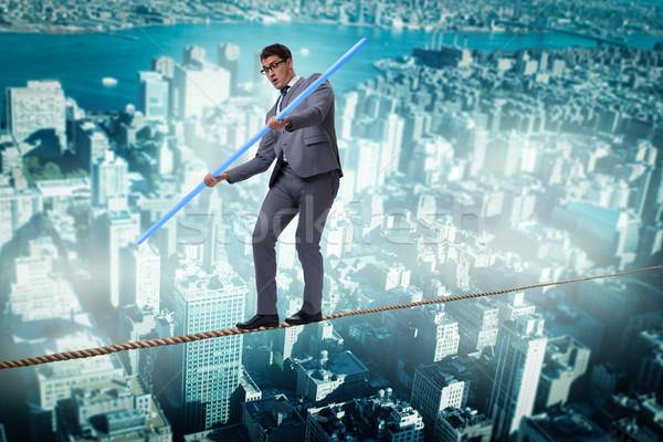 бизнесмен туго натянутый канат ходьбе риск фон зданий Сток-фото © Elnur