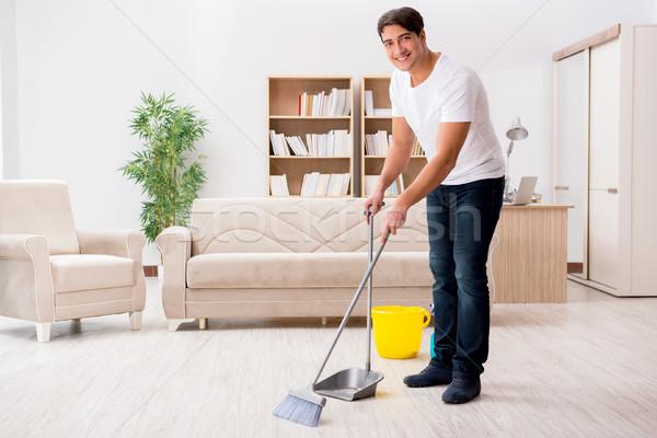 Homem limpeza casa vassoura indústria trabalhando Foto stock © Elnur