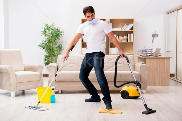 Férfi takarítás otthon porszívó boldog munka Stock fotó © Elnur