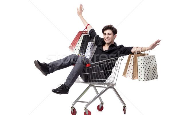 Stock fotó: Fiatalember · bevásárlókocsi · szatyrok · izolált · fehér · vásárlás