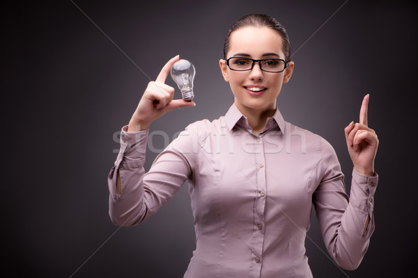 Businesswoman with lightbulb in business concept Stock photo © Elnur