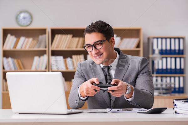 Stock fotó: üzletember · játszik · számítógép · játékok · munka · iroda