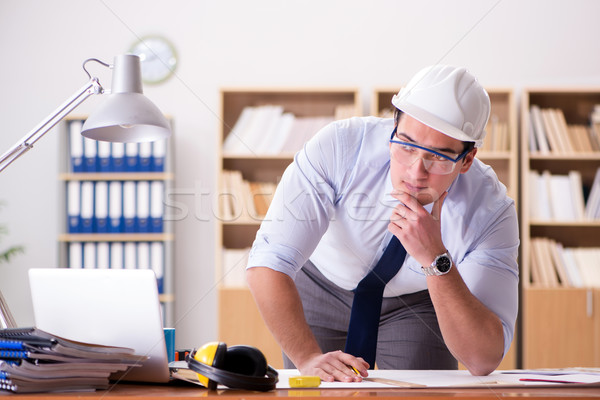The engineer supervisor working on drawings in the office Stock photo © Elnur