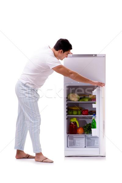 Сток-фото: человека · холодильник · полный · продовольствие · дома · счастливым