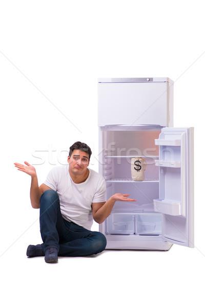 Hungrig Mann schauen Geld Kühlschrank Essen Stock foto © Elnur
