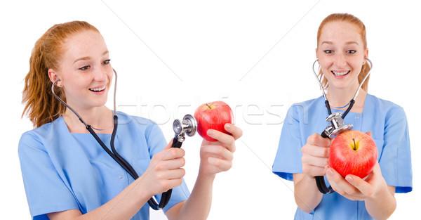 Bastante médico azul uniforme estetoscopio manzana Foto stock © Elnur