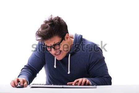 Vicces stréber férfi dolgozik számítógép izolált Stock fotó © Elnur