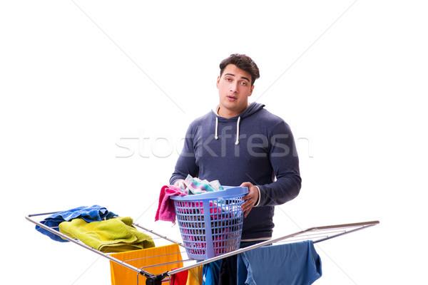 The husband man doing laundry isolated on white Stock photo © Elnur