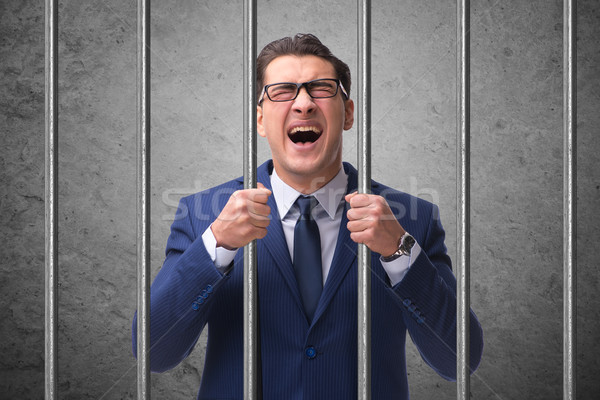 Młodych biznesmen za bary więzienia działalności Zdjęcia stock © Elnur
