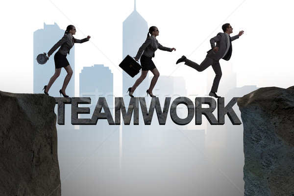 The teamwork concept with business people crossing bridge Stock photo © Elnur