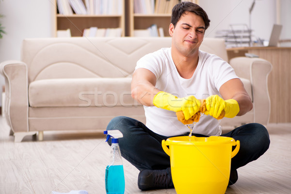 Man husband cleaning the house helping wife Stock photo © Elnur