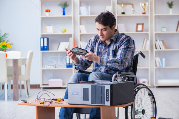 Computer repairman on wheelchair working Stock photo © Elnur