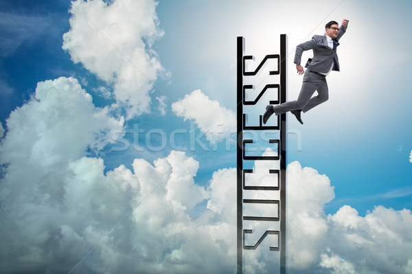 Businessman slipping from the top of ladder Stock photo © Elnur