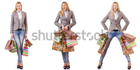 The woman in fashion looks isolated on white Stock photo © Elnur